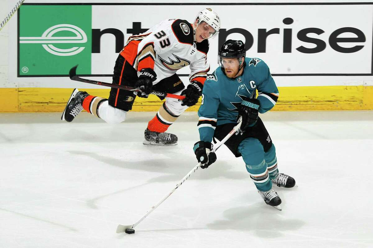 SAN JOSE, CA - APRIL 16: Joe Pavelski #8 of the San Jose Sharks controls the puck ahead of Jakob Silfverberg #33 of the Anaheim Ducks in Game Three of the Western Conference First Round during the 2018 NHL Stanley Cup Playoffs at SAP Center on April 16, 2018 in San Jose, California. (Photo by Scott Dinn/NHLI via Getty Images)