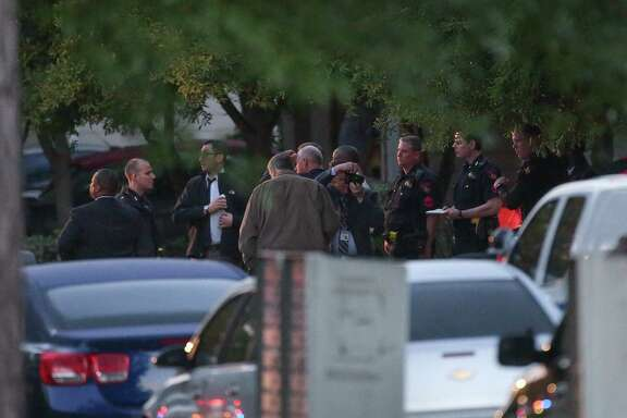 Officials investigate the scene where a suspect shot at Harris County Precinct 4 Constable deputies on the 12400 block of Saratoga Woods Lane Tuesday, April 17, 2018, in Humble, Texas.