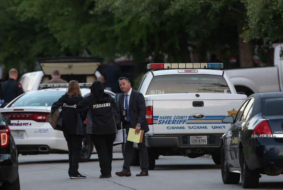 Officials investigate the scene where a suspect shot at Harris County Precinct 4 Constable deputies on the 12400 block of Saratoga Woods Lane Tuesday, April 17, 2018, in Humble, Texas. Photo: Godofredo A. Vasquez, Houston Chronicle