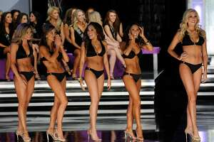(L-R) Brittany Jeffers, Miss Nebraska, Kristen Blair, Miss Texas, Caressa Cameron, Miss Virginia, Nicole Miner, Miss New Mexico and Jen Corey, Miss District of Columbia, wait to see who will advance after competing in the swimsuit competition during the 2010 Miss America Pageant at the Planet Hollywood Resort & Casino January 30, 2010 in Las Vegas, Nevada. Cameron went on to be crowned the new Miss America.