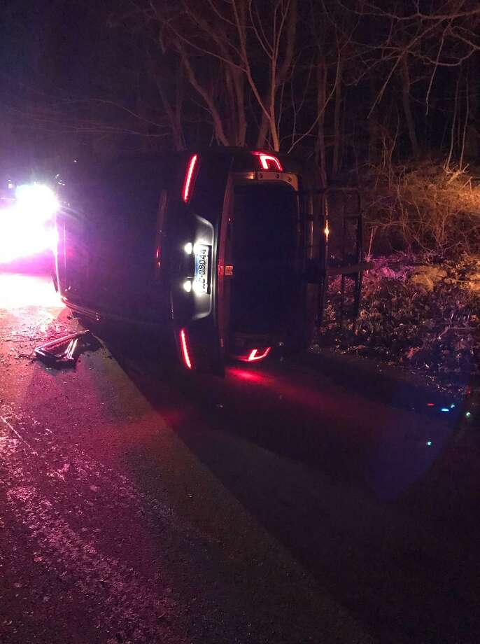 As an officer approached the area, the stolen Honda minivan struck the front of the officer's patrol vehicle, traveled off the roadway, hitting a rock and rolling onto its side around 9:45 p.m. Photo: Photo Courtesy Of Branford Police