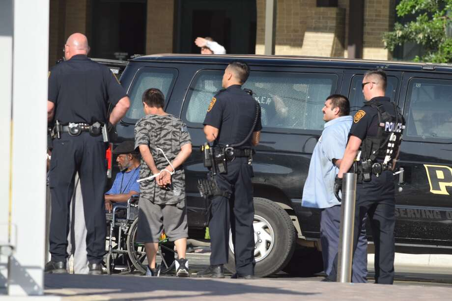 San Antonio police conducted a joint operation at the corner of Houston and Frio streets on Tuesday, April 17, 2018. Photo: Caleb Downs / San Antonio Express-News