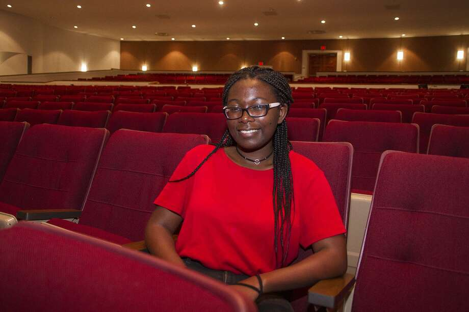 Mikayla Johnson, 17, a junior at Edgewood Fine Arts Academy, takes a break from a rehearsal to talk about receiving a Texas Young Masters award. Photo: Alma E. Hernandez / For The San Antonio Express News