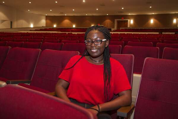 Mikayla Johnson, 17, a junior at Edgewood Fine Arts Academy, takes a break from a rehearsal to talk about receiving a Texas Young Masters award.