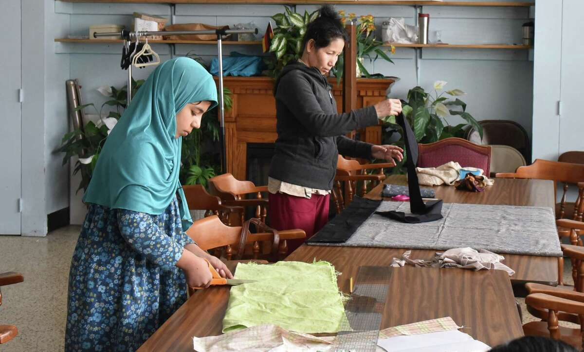 Refugees in the Capital Region attend a sewing class at the McManus Center in Rensselaer on April 14, 2018. The classes, sponsored by the Literacy Volunteers of Rensselaer County, take place every Saturday to help refugees practice their sewing and English skills. (Massarah Mikati/Times Union)
