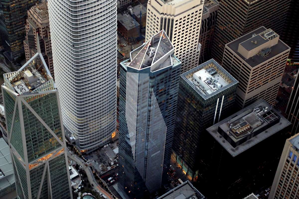 Millennium Tower, center, which has sunk a foot-and-a-half and is leaning 14 inches toward neighboring high rises, in San Francisco, Feb. 8, 2018. California has strict building requirements to protect schools and hospitals from a major earthquake. But not skyscrapers. A five-story building has the same strength requirements as a 50-story building. (Jim Wilson/The New York Times)