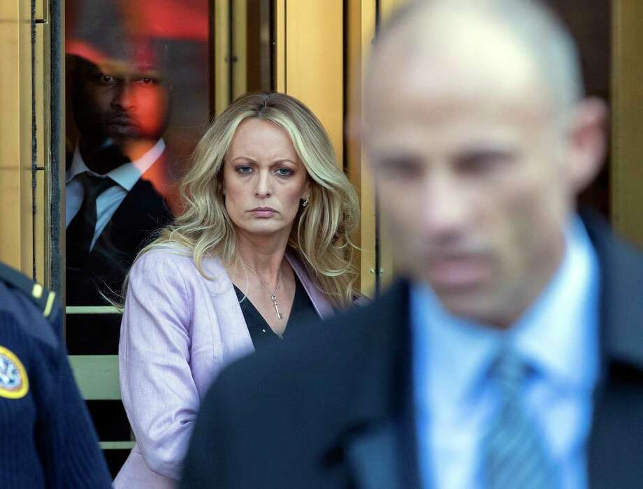Adult film actress Stormy Daniels, left, follows her attorney Michael Avenatti, right, as she leaves federal court, Monday, April 16, 2018, in New York. Photo: Mary Altaffer, AP / Copyright 2018 The Associated Press. All rights reserved.