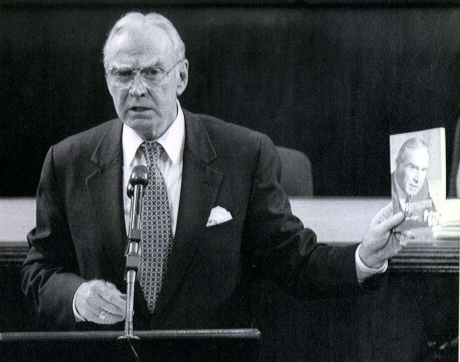 House Speaker Jim Wright of Texas holds a copy of his book during his resignation speech before the House of Representatives on Capitol Hill, May 31, 1989. Wright was charged with selling bulk copies of his book to groups to which he had given speeches. Photo: J. Scott Applewhite /Associated Press / EXPRESS-NEWS FILE PHOTO