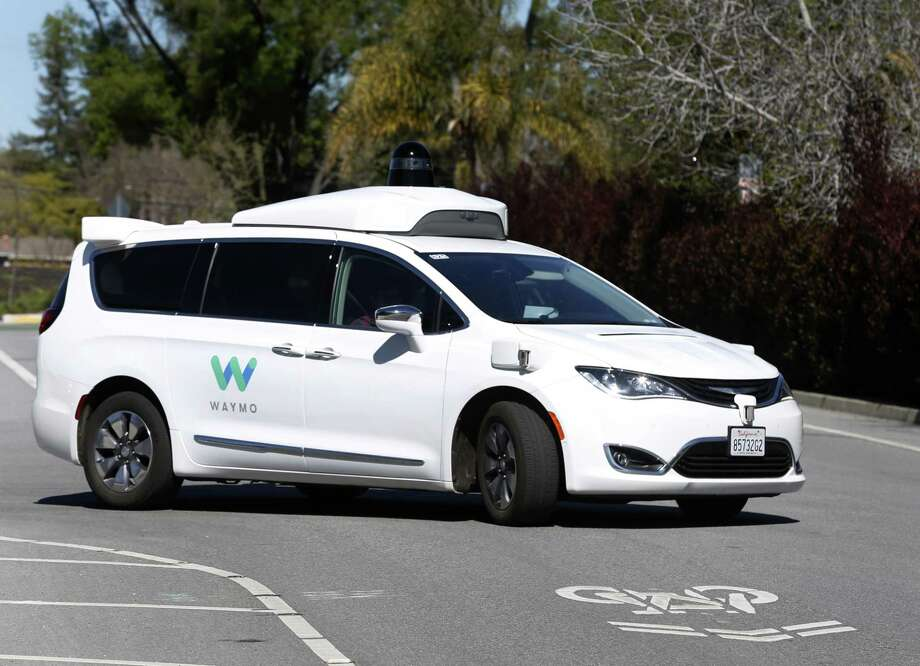 A Waymo self-driving car drives on a residential street in Mountain View, Calif. on Wednesday, March 28, 2018. Photo: Paul Chinn / The Chronicle / ONLINE_YES