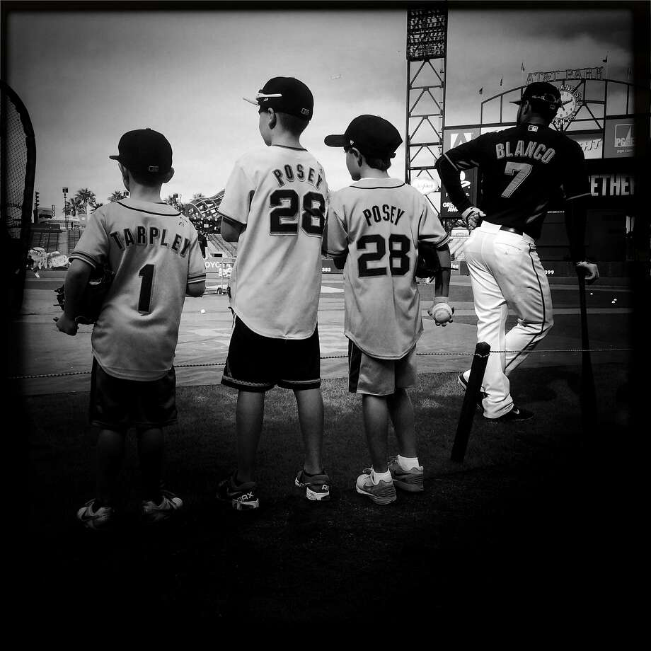 Young fans wear authorized Giants shirts in August 2014. Photo: Scott Strazzante / The Chronicle