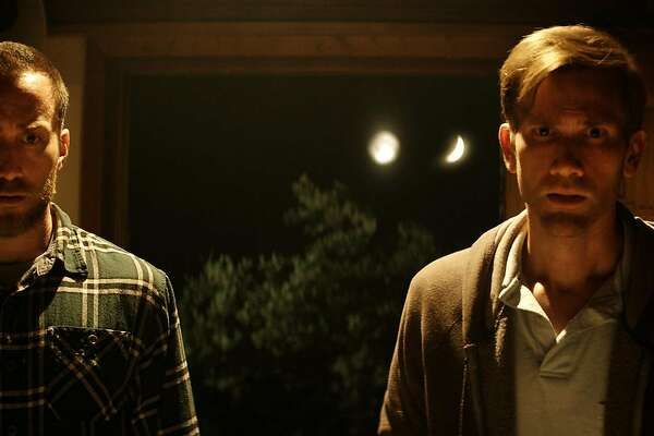 Brothers Justin (Justin Benson, left) and Aaron (Aaron Moorhead) find themselves drawn back to their old UFO cult in the psychological horror thriller �The Endless.�