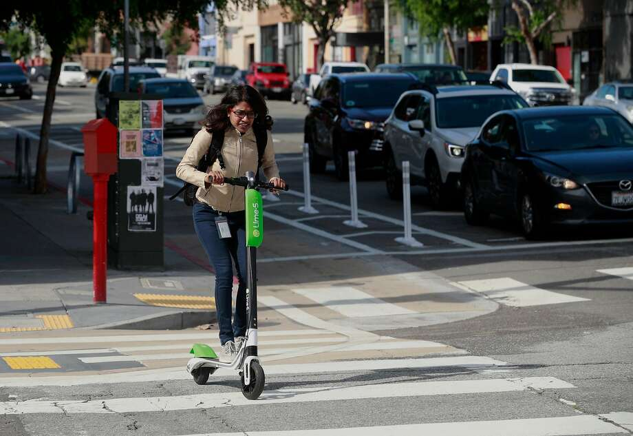 A rider aboard a Lime scooter cruises down Folsom St. as seen on Mon. April 9, 2018, in San Francisco, Calif. Photo: Michael Macor / The Chronicle