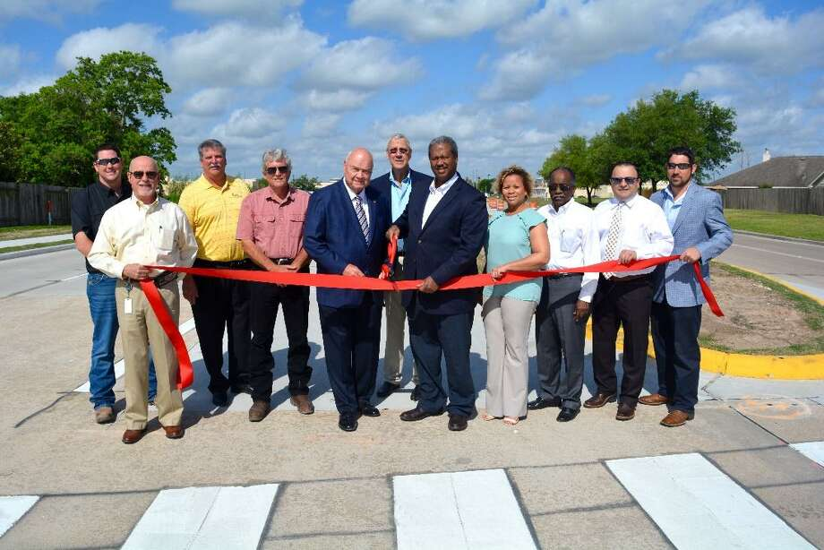 Pictured from left are Michael Boenig, Allgood Construction; Richard Stolleis, County Engineer;  Bob Baker, Othon, Inc.; Wesley Crawford, Fort Bend County Engineering;  Fort Bend County Judge Robert Hebert, Commissioner James Patterson, Commissioner Grady Prestage, Felecia Evans-Smith, Commissioner Prestage's Office; David Collins, FCM Engineers, P.C.;  Bassem Talje, RPS;  and Cody Bathe, RPS. Photo: Courtesy Photo / Courtesy Photo