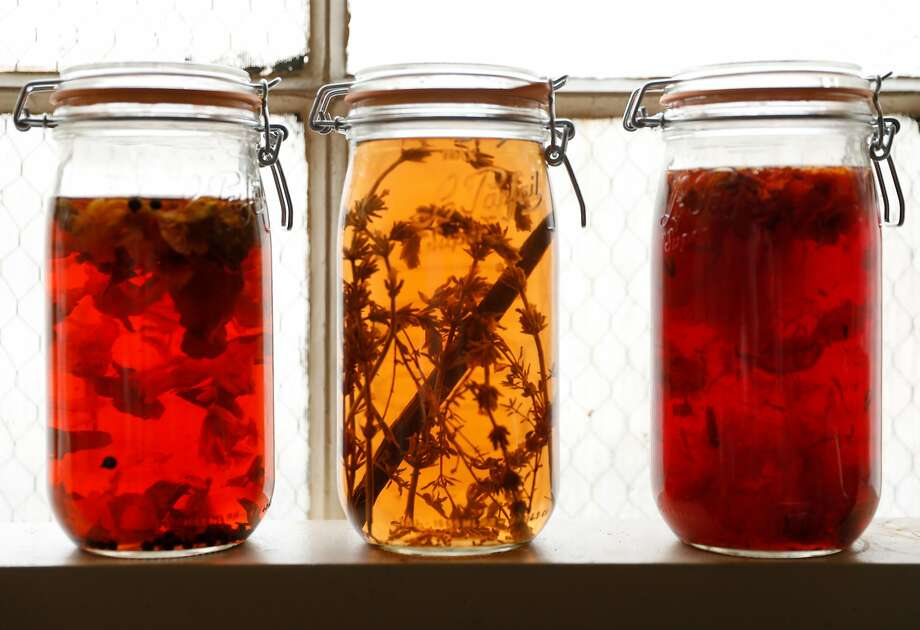 Floral-infused vinegars including nasturtium (left); lavender vanilla; and a floral mix. Photo: Russell Yip / The Chronicle