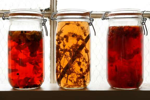 Floral infused vinegars including nasturtium, left, lavender vanilla, and a floral mix are seen on Wednesday, April 4, 2018 in San Francisco, Calif.