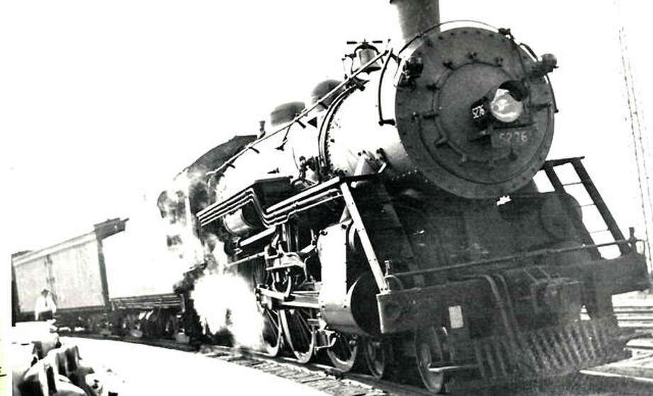 Alton P-14 class Pacific no. 5276 cools her 80-inch drivers on the tight curve at Alton Union Station in 1932. The ice-cooled express car was used for loading fresh asparagus for the tables of Chicago. Photo:       File Photo