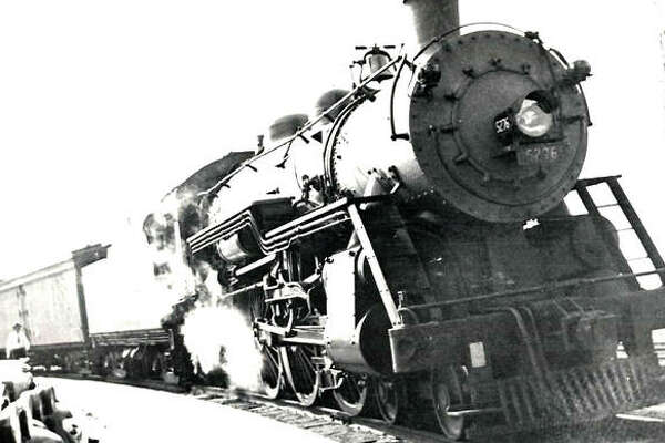 Alton P-14 class Pacific no. 5276 cools her 80-inch drivers on the tight curve at Alton Union Station in 1932. The ice-cooled express car was used for loading fresh asparagus for the tables of Chicago.