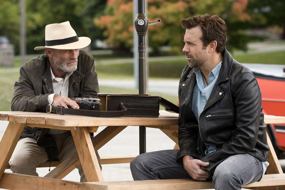 This image released by Netflix shows Ed Harris, left, and Jason Sudeikis in a scene from