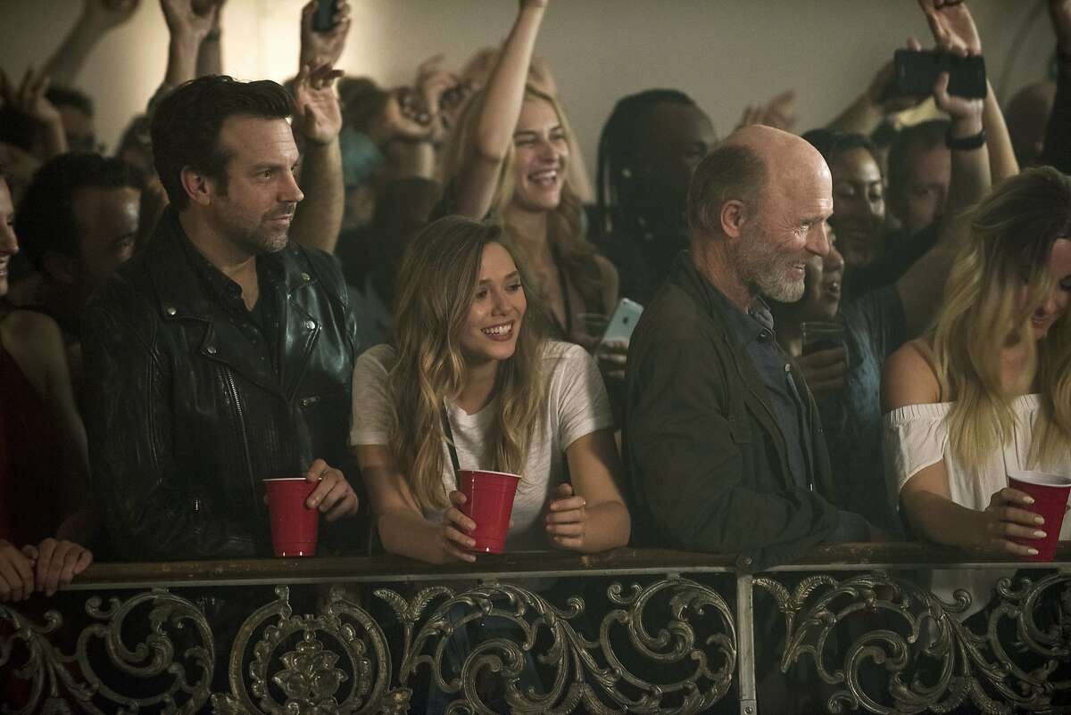 This image released by Netflix shows Jason Sudeikis, from left, Elizabeth Olsen and Ed Harris in a scene from