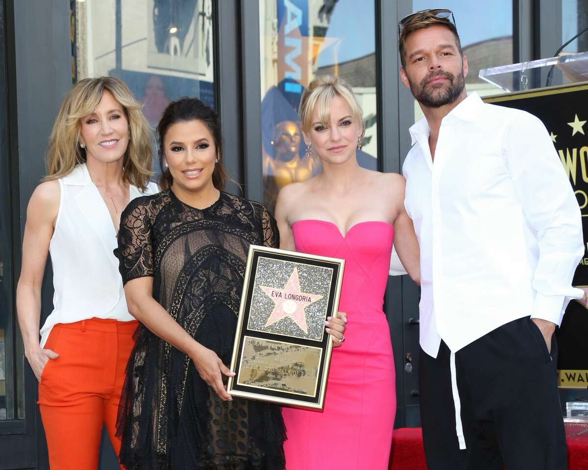 HOLLYWOOD, CA - APRIL 16: (L-R) Felicity Huffman, Eva Longoria, Anna Faris and Ricky Martin attend the ceremony to honor Eva Longoria with a Star on The Hollywood Walk Of Fame on April 16, 2018 in Hollywood, California. (Photo by Paul Archuleta/FilmMagic)
