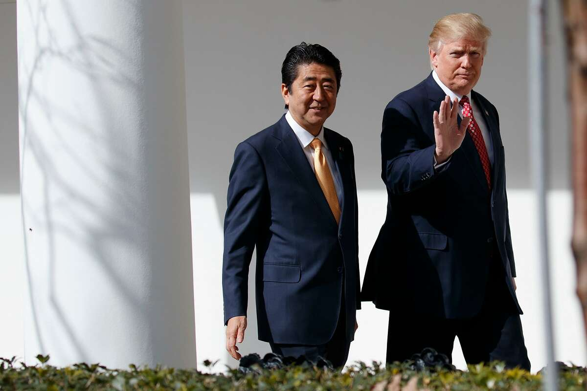 FILE - In this Feb. 10, 2017, file photo, Japanese Prime Minister Shinzo Abe, left, walks with U.S. President Donald Trump for a news conference at the White House in Washington. Abe is heading to Trump�s Mar-a-Lago resort Tuesday, April 17, 2018 for two days of talks, hoping to keep Japan�s interests on the table in a possible U.S.-North Korea summit as well as stem a slide in his voter support ratings. (AP Photo/Evan Vucci, File)