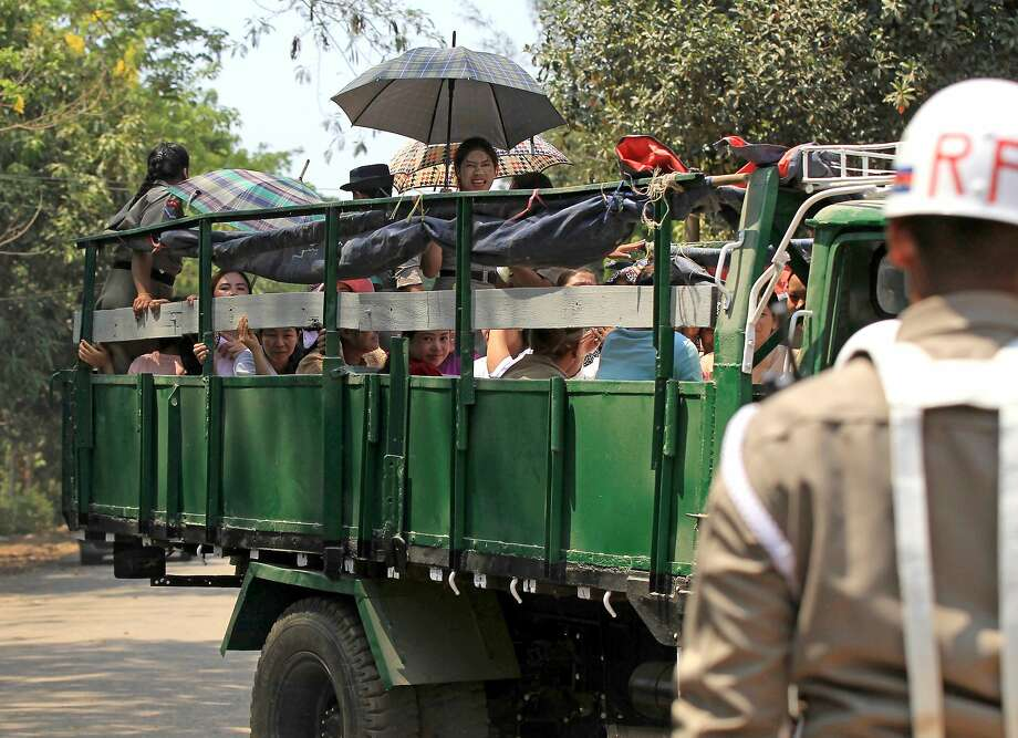 A truck carrying released prisoners parks near the gate at Insein prison in Yangon, Myanmar. Photo: Thein Zaw / Associated Press