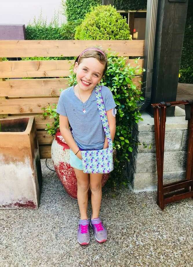 Devin Dyer, a 2nd-grader at Nottingham Elementary School, has Type 1 diabetes. Her classmates worked to create special purses so that she could carry a device that constantly monitors her blood sugar in order to keep her well. Photo: Courtesy Photo