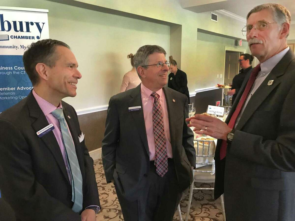 Economist Don Klepper-Smith, right, speaks with Tony Giobbi and Ken Weinstein of Newtown Savings Bank during the Greater Danbury Chamber of Commerce's 2018 Economic Forecast Breakfast held Tuesday, April 17, 2018, at Ridgewood Country Club in Danbury, Conn.