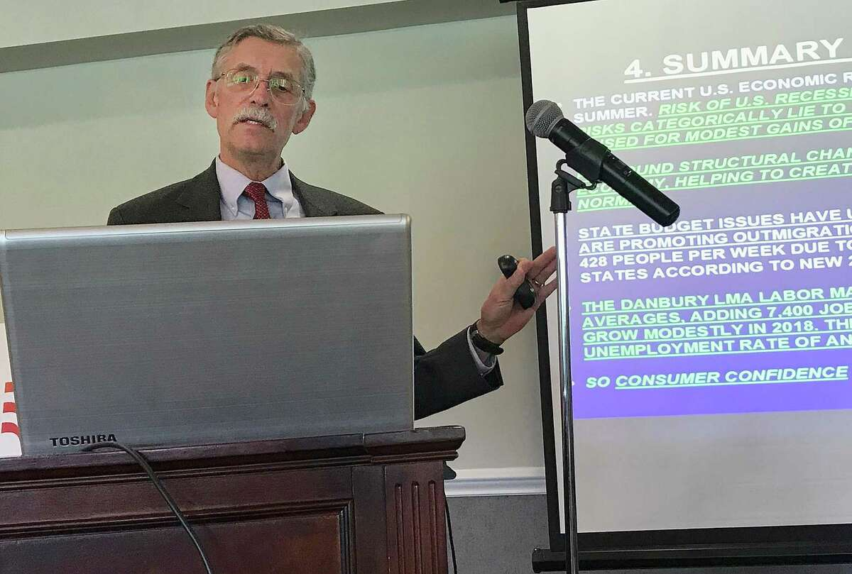 Economist Don Klepper-Smith, right, speaks during the Greater Danbury Chamber of Commerce's 2018 Economic Forecast Breakfast held Tuesday, April 17, 2018, at Ridgewood Country Club in Danbury, Conn.