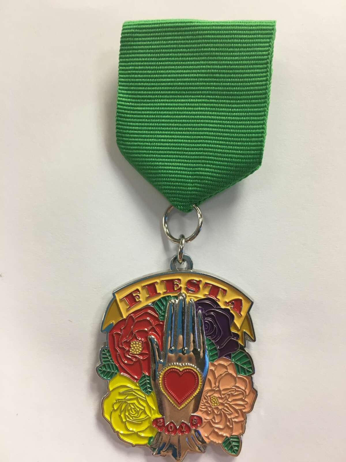 """Denise Ojeda's 2018 """"Heart in Hand Milagro"""" Fiesta Medal is inspired by her home, faith and culture. $10 at the SA Flavor website, with $1 of each sale benefitting Big Brothers and Big Sisters of South Texas."""