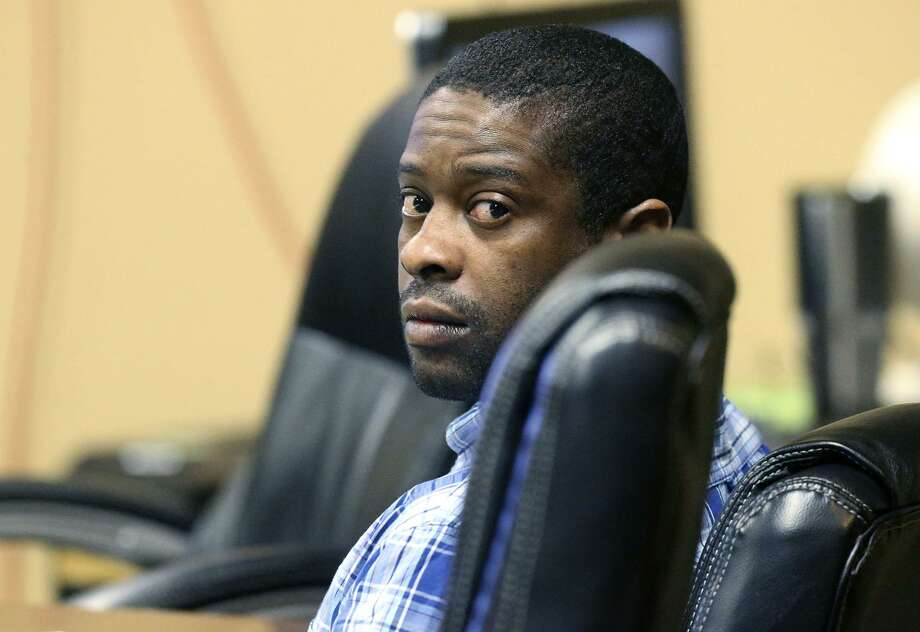 Child abuse defendant Deandre Dorch, 38, sits in Felony Impact Court on Tuesday. Dorch is one of three defendants in a child abuse case that took place in the Camelot II subdivision in 2016 in which two young children were found in the backyard of a home bound like animals. Photo: John Davenport /San Antonio Express-News / ©John Davenport/San Antonio Express-News