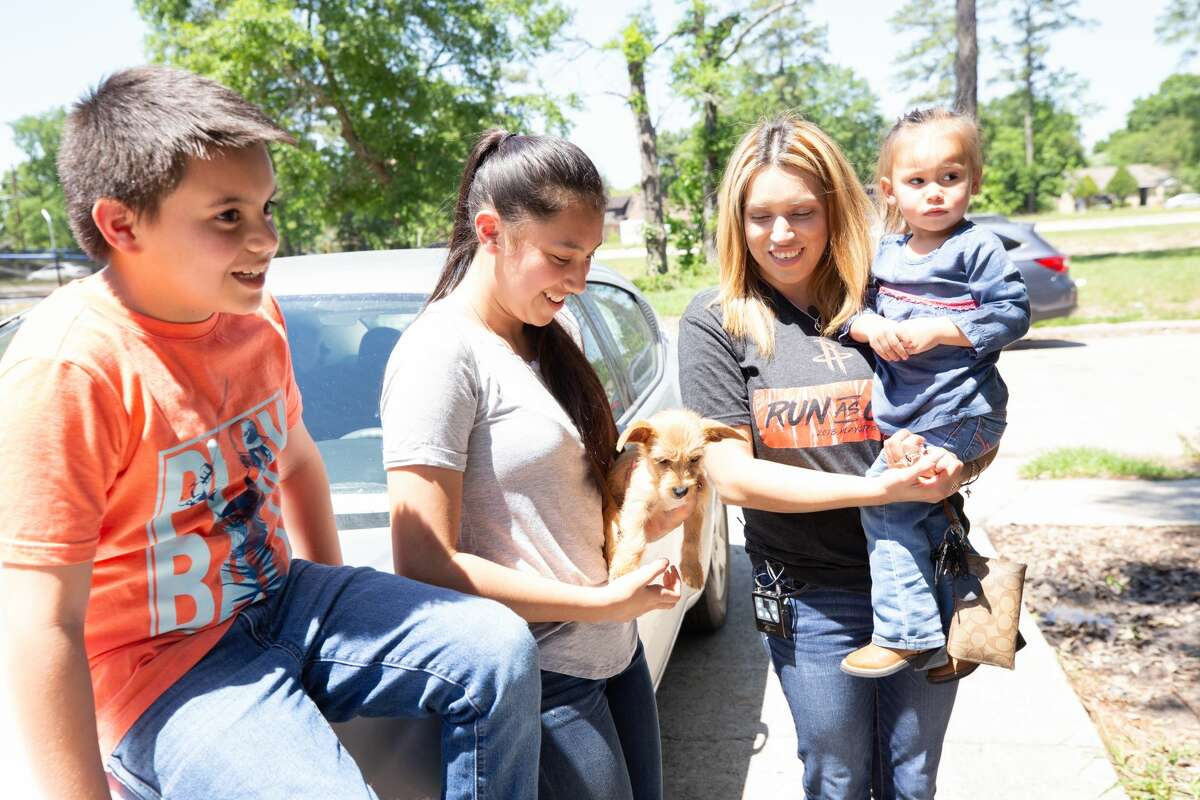 Margarita Garza and her three children, Jose Luis, Sophia and Noemi Tudon, await the big reveal when Rooms to Go, the Houston Rockets and Marie Flanigan Interiors gave her post-hurricane repaired home an interior design facelift.