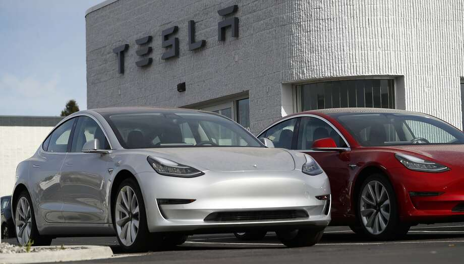 Tesla has paused production of the Model 3, like these seen on a dealer's lot near Denver, to make upgrades to its assembly line it hopes will boost output. Photo: David Zalubowski / Associated Press