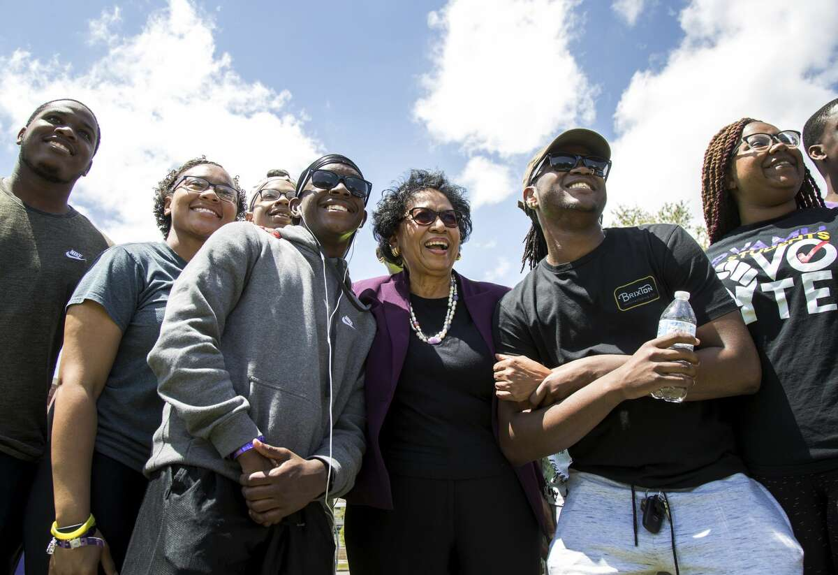 Ruth Simmons, center, president of Prairie View A&M University, poses with students during a campus festival, at Prairie View A&M University, Thursday, in Prairie View. ( Jon Shapley / Houston Chronicle )