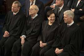 FILE-- Supreme Court Justices attend President Donald Trump's State of the Union address in the House Chamber of the U.S. Capitol in Washington, Jan. 30, 2018. The Supreme Court on April 17, 2018, struck down a law that allowed the government to deport some immigrants who commit serious crimes, saying it was unconstitutionally vague. The decision will limit the Trump administrationÕs efforts to deport people convicted of some kinds of crimes. The vote was 5 to 4, with Gorsuch joining the courtÕs four more liberal members. From left: Chief Justice John Roberts, Justice Stephen Breyer, Justice Elena Kagan, and Justice Neil Gorsuch. (Tom Brenner/The New York Times)