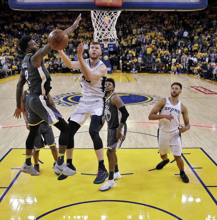 Jordan Bell (2) defends against a shot by Davis Bertans (42) in the second half as the Golden State Warriors played the San Antonio Spurs in Game 2 of the first round of the Western Conference Finals in Oakland, Calif., on Tuesday, April 17, 2018. Photo: Carlos Avila Gonzalez, Staff Photographer / The Chronicle / ONLINE_YES