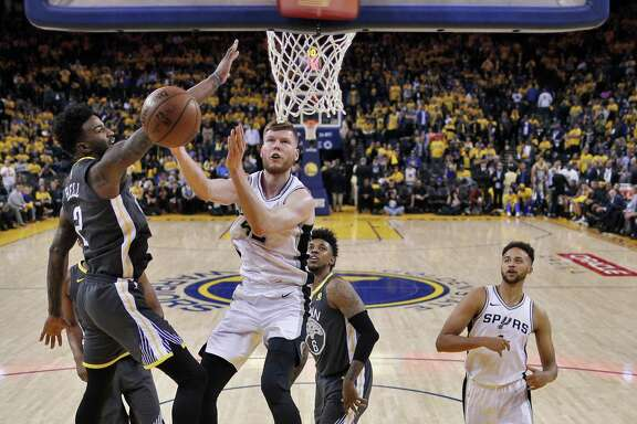 Jordan Bell (2) defends against a shot by Davis Bertans (42) in the second half as the Golden State Warriors played the San Antonio Spurs in Game 2 of the first round of the Western Conference Finals in Oakland, Calif., on Tuesday, April 17, 2018.