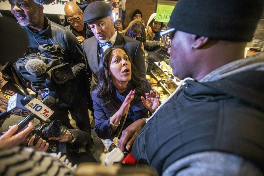 Camille Hymes, center, regional vice president of Mid-Atlantic operations at Starbucks Coffee Company, speaks with Asa Khalif, of Black Lives Matter, right, after protesters entered the coffee shop, Sunday, April 15, 2018, demanding the firing of the manager who called police resulting in the arrest of two black men on Thursday. The arrests were captured on video that quickly gained traction on social media. Photo: Michael Bryant /Associated Press / The Philadelphia Inquirer