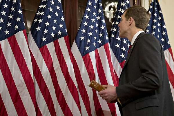 Representative-elect Conor Lamb, a Democrat from Pennsylvania, looks at American flags in the speakers ceremonial room before a mock swearing-in with U.S. House Speaker Paul Ryan, a Republican from Wisconsin, not pictured, at the U.S. Capitol in Washington, D.C., U.S., on Thursday, April 12, 2018. Lamb pulled off upset in special election last month for seat that had been in Republican hands for 15 years defeating Republican State Representative Rick Saccone. Photographer: Andrew Harrer/Bloomberg