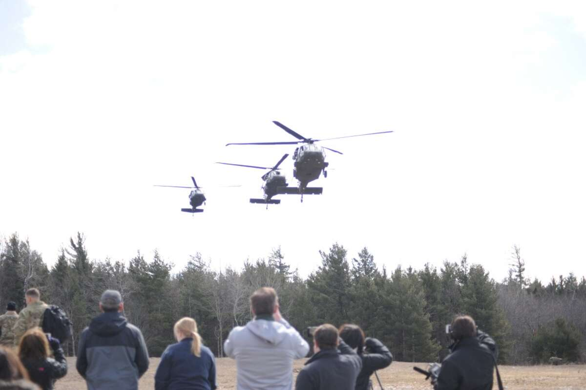 Local officials, members of the media and invited guests arrive at Fort Drum's Range 48 via UH-60 Black Hawks on April 9, 2018, to get a better perspective on the 10th Combat Aviation Brigade's Falcon's Peak training exercise.