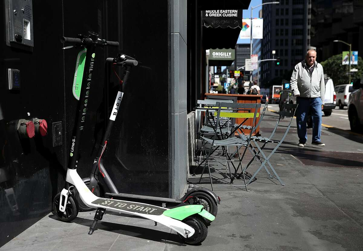 File photo of a Lime and Bird scooter parked in front of a building in San Francisco.
