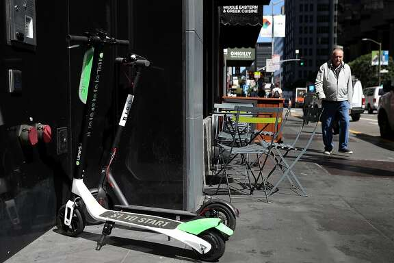 SAN FRANCISCO, CA - APRIL 17:  Bird and Lime scooters sit parked in front of a building on April 17, 2018 in San Francisco, California. Three weeks after three companies started placing electric scooters on the streets for rental, San Francisco City Attorney Dennis Herrera issued cease-and-desist notice to electric scooter rental companies Bird, LimeBike and Spin. The notice comes as the San Francisco board of supervisors considers a proposed ordinance to regulate the scooters to keep people from riding them on sidewalks, parking them in the middle of sidewalks and requiring riders to wear helmets and have a drivers license.  (Photo by Justin Sullivan/Getty Images)