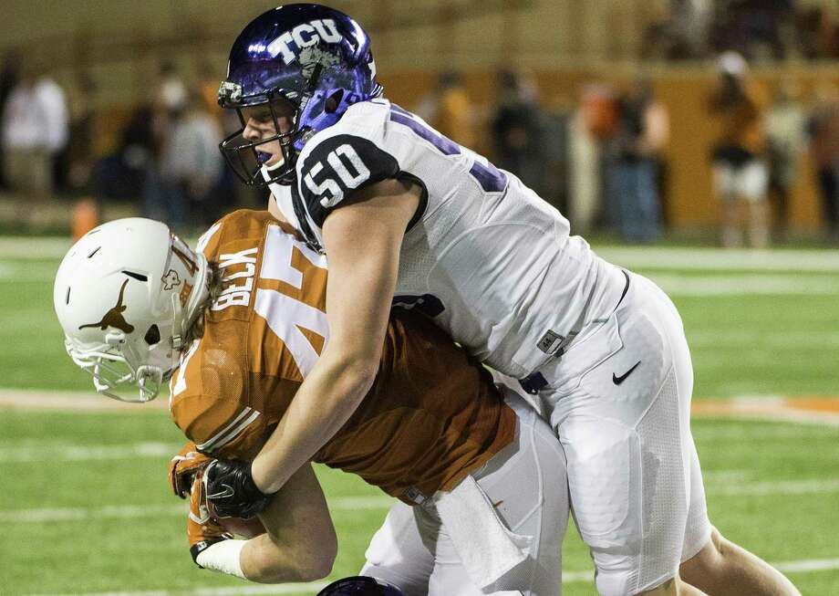 TCU's James Power (50) and Nick Orr (18) tackle Texas' Andrew Beck (47) during the first half of an NCAA college football game, Thursday, Nov. 27, 2014, in Austin, Texas. (AP Photo/Ashley Landis) Photo: Ashley Landis, FRE / Associated Press / FR171265 AP