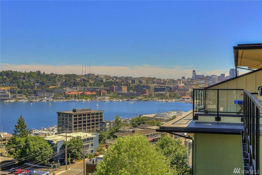 High ceilings and open living abound in this single-level condo with ample views, to boot. Gaze out on Lake Union from Gas Works to downtown, from the top floor, with kitchen rocking granite and a gas fireplace.