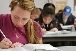 NEWTON - MARCH 3: Alexis Zelada works on a sample SAT during her Kaplan SAT Course in Newton, Massachusetts on March 3, 2005. The class, taught at one of Kaplan's Test Prep and Admissions centers, helps prepare high school students for the SAT. (Photo by John Nordell/The Christian Science Monitor via Getty Images)