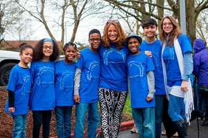 FILE - This March 20, 2016, file photo shows Hart family of Woodland, Wash., at a Bernie Sanders rally in Vancouver, Wash. A body was recovered Saturday, April 7, 2018, in the vicinity where an SUV plunged off a Northern California cliff last month, killing the family of eight in what authorities suspect may have been an intentional crash. One of the women were drunk when she drove her large family off a Northern California cliff last month and her wife and several children had large amounts of a drug in their systems that can cause drowsiness, authorities said Friday, April 13, 2018. (Tristan Fortsch/KATU News via AP, File)