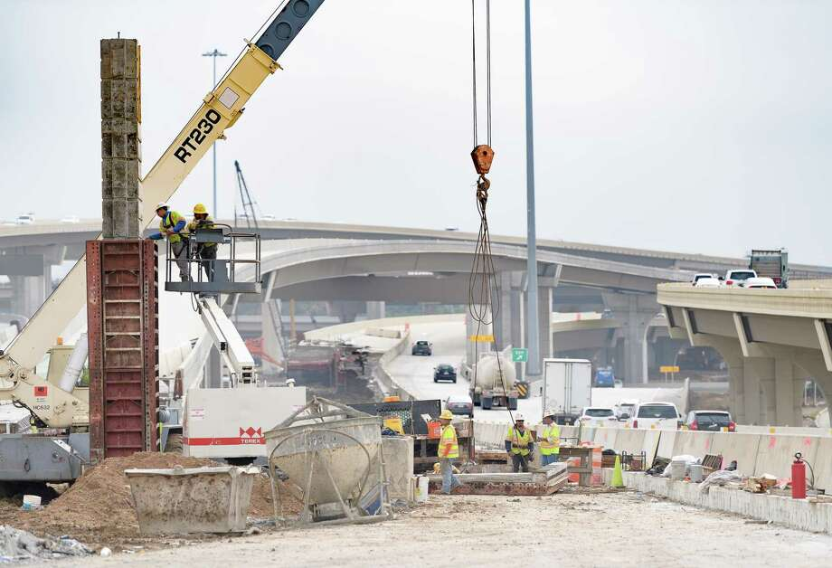 Construction employment is at a record high in Texas, but industry leaders believe the sector would grow even more quickly if it had access to more labor. As a result, the Associated General Contractors of America are calling for immigration reform. Here, workers remove a form from a new sign post during construction on Highway 290 on Thursday, December 21, 2017 in Houston Texas. Photo: Wilf Thorne / For The Chronicle / © 2017 Houston Chronicle
