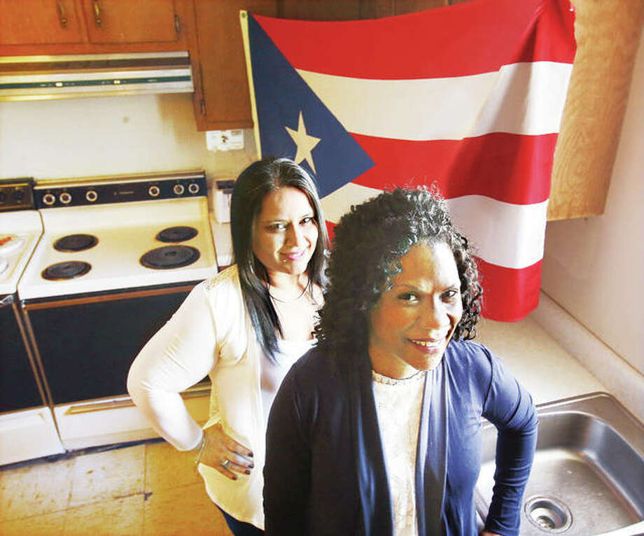 Pastor Tanya Brown, right, and Karen C. Vazquez, left, stand in the kitchen of the Bethesda Temple Church on Spring Street in Alton, where Vazquez will cook the food for a special Hispanic culture celebration on Sunday, April 22, with an emphasis on new area arrivals from Puerto Rico. Photo:       John Badman | The Telegraph