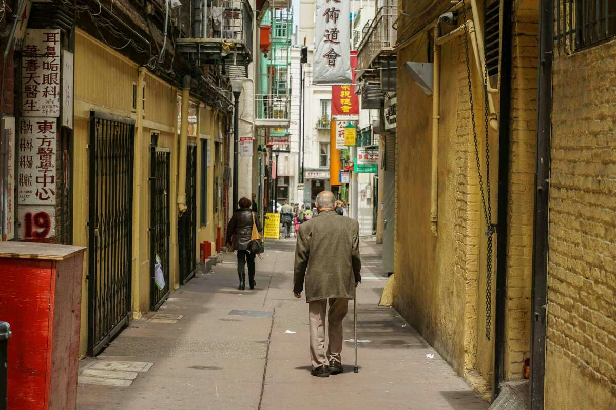 A view down an alley in San Francisco's Chinatown. PhotographerSamJohnson celebrates and explores the neighborhood on his Instagram page @ChinatownSanFrancisco.