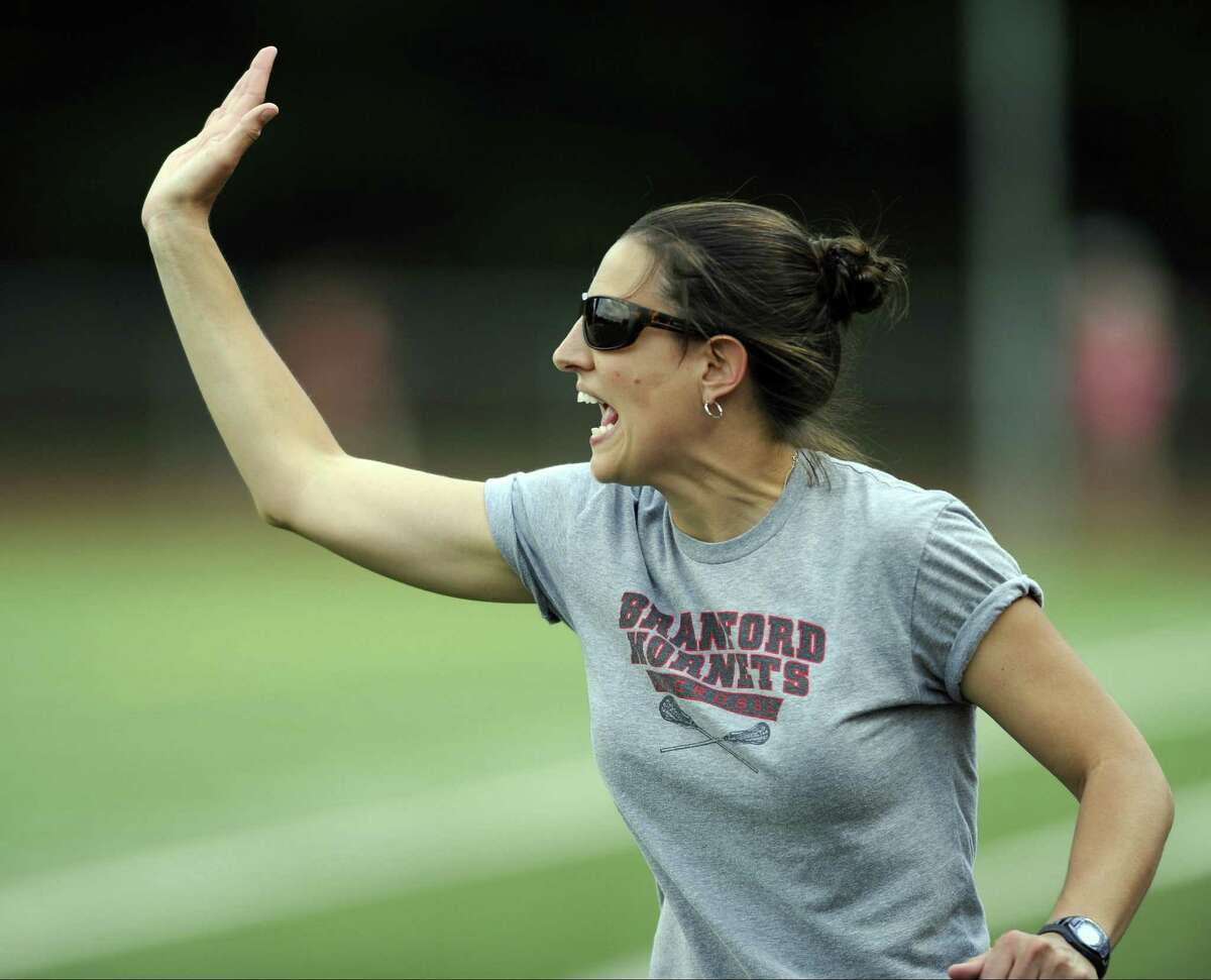 Branford coach Jackie Ceccolini shouts to her play during second half action against Pomperaug in a CIAC Class M girls lacrosse championship at Jonathan Law High School in Milford, Conn., on Friday, June 10, 2017. Branford defeated Pomperaug 15-8.